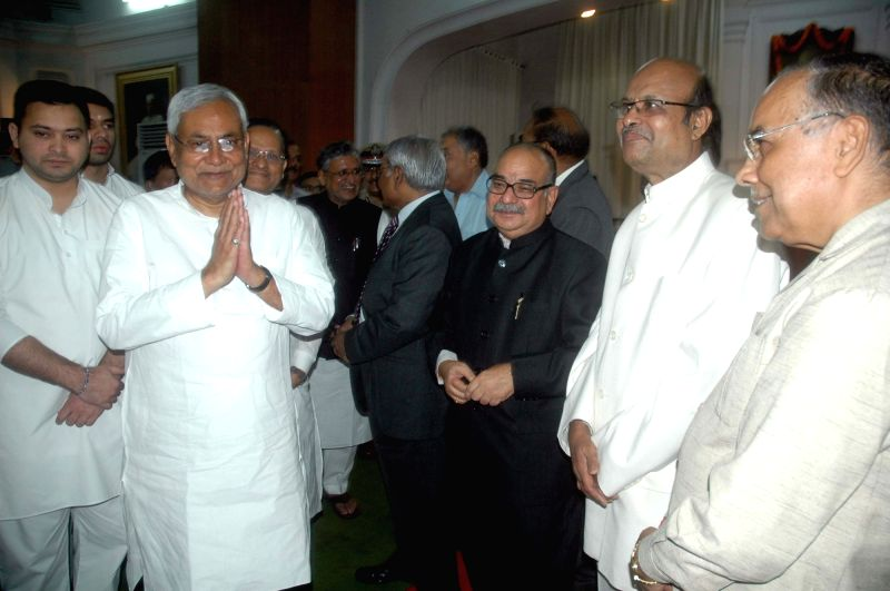 Bihar Chief Minister Nitish Kumar and Deputy Chief Minister Tejashwi Yadav arrive during the swearing in ceremony of the Lokayukta of Bihar in Patna, on May 18, 2016. - Nitish Kumar and Tejashwi Yadav