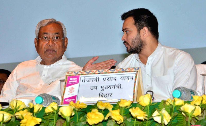 Bihar Chief Minister Nitish Kumar and Deputy Chief Minister Tejashwi Yadav during a programme in Patna, on June 16, 2017. - Nitish Kumar and Tejashwi Yadav
