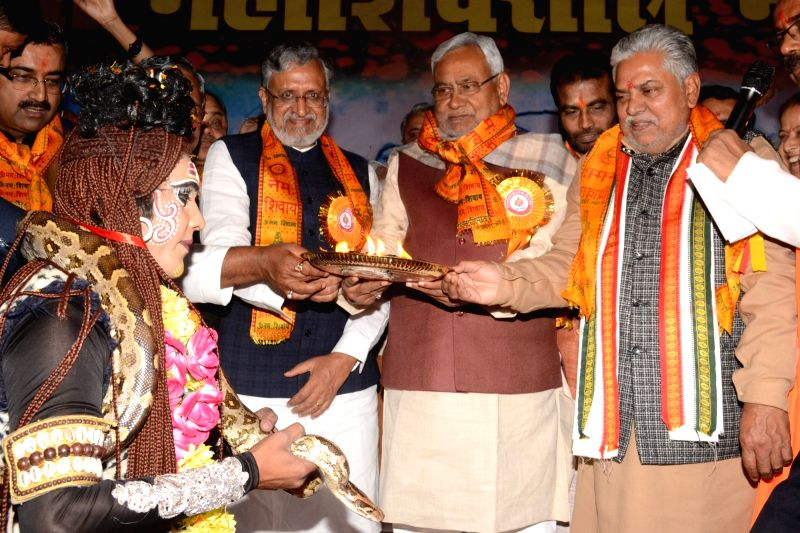 Bihar Chief Minister Nitish Kumar and Deputy Chief Minister Sushil Kumar Modi during a programme organised on the occasion of Maha Shivaratri in Patna on Feb 13, 2018. - Nitish Kumar and Sushil Kumar Modi