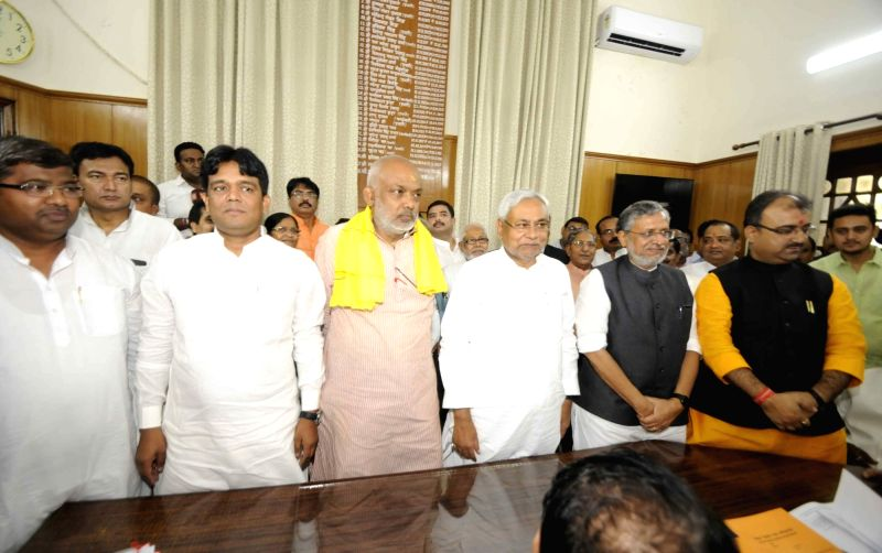 Bihar Chief Minister Nitish Kumar and Deputy Chief Minister Sushil Kumar Modi with NDA candidates contesting upcoming for Bihar Legislative Council elections in Patna, on April 16, 2018. - Nitish Kumar and Sushil Kumar Modi
