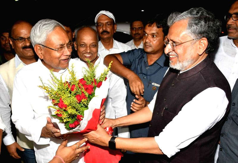Bihar Chief Minister Nitish Kumar and Deputy Chief Minister Sushil Kumar Modi during a get-togetherr programme organsied by NDA in Patna, on June 7, 2018. - Nitish Kumar and Sushil Kumar Modi