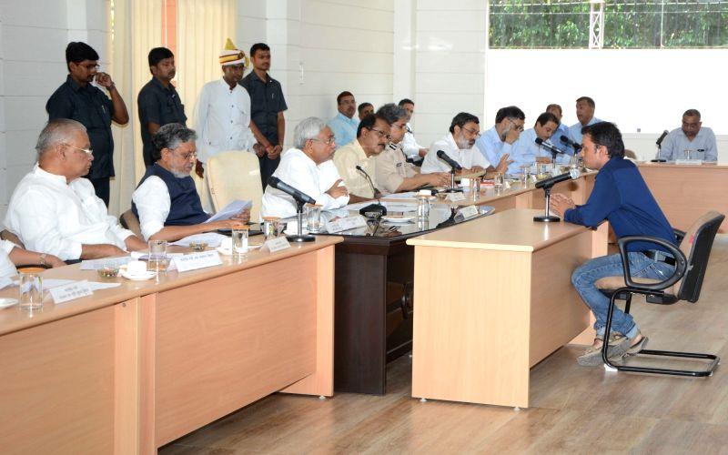 Bihar Chief Minister Nitish Kumar and Deputy Chief Minister Sushil Kumar Modi during Lok Samvad programme at Samvad Bhawan in Patna on June 11, 2018. - Nitish Kumar and Sushil Kumar Modi