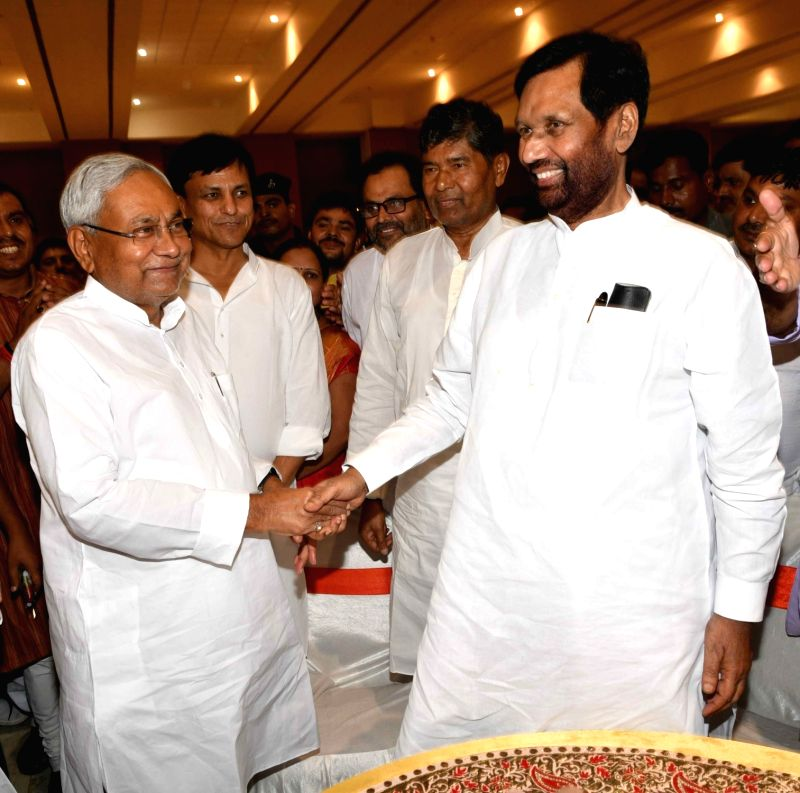 Bihar Chief Minister Nitish Kumar and LJP chief and Union Minister for Consumer Affairs, Food and Public Distribution Ramvilas Paswan during a get-togetherr programme organsied by NDA in ... - Nitish Kumar