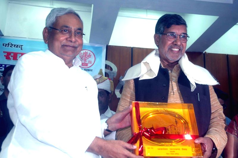 Bihar Chief Minister Nitish Kumar and Nobel Peace Laureate Kailash Satyarthi during a programme in Patna on July 26, 2016. - Nitish Kumar and Kailash Satyarthi