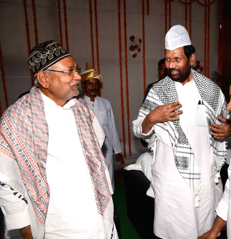 Bihar Chief Minister Nitish Kumar and Union Minister Ram Vilas Paswan during an iftaar party at Haj Bhavan in Patna, on June 13, 2018. - Nitish Kumar