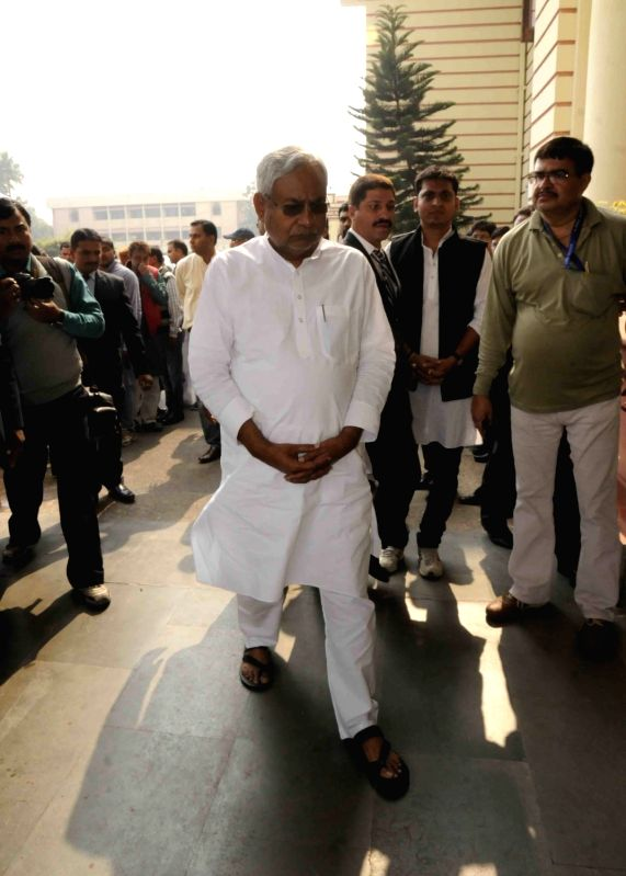 Bihar Chief Minister Nitish Kumar arrives to pay their last respect to Rashtriya Lok Samata Party (RLSP) MLA Basant Kumar Kushwaha who died of heart attack in Patna on Nov 30, 2015. - Nitish Kumar and Basant Kumar Kushwaha