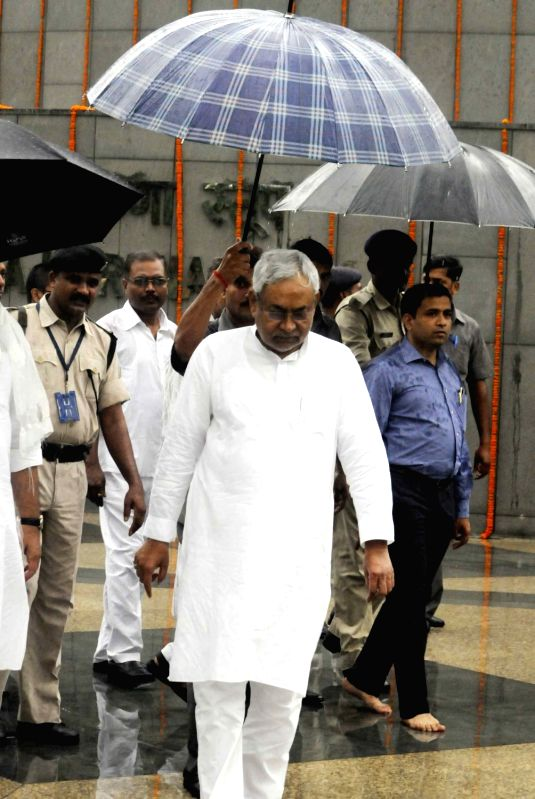 Bihar Chief Minister Nitish Kumar arrives to pay tribute on the occassion of Buddha Purnima at Buddha Smriti Park in Patna, on May 21, 2016. - Nitish Kumar
