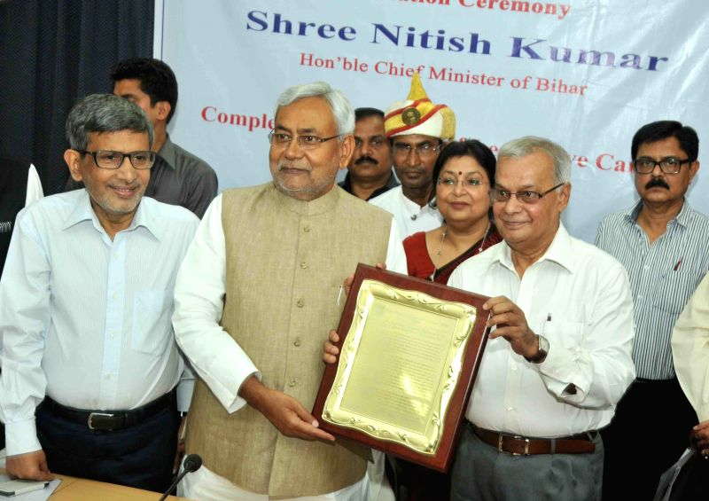 Bihar Chief Minister Nitish Kumar being felicitated  during a programme in Patna on March 24, 2015. - Nitish Kumar