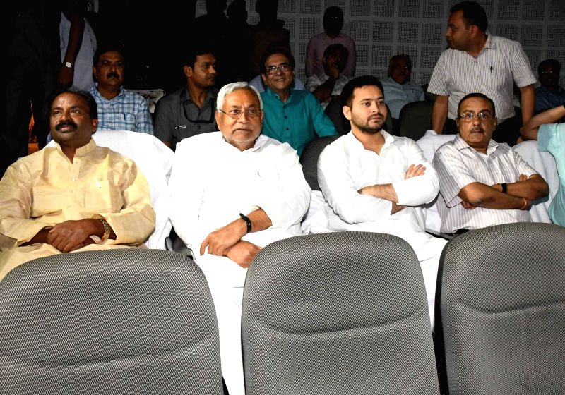 Bihar Chief Minister Nitish Kumar (C) Deputy Chief Minister Tejaswi Yadav (L) and Art and culture Minister Shiv Chandra Ram watch film on Mahatma Gandhi during Gandhi Panorama Film Festival at ... - Nitish Kumar and Tejaswi Yadav