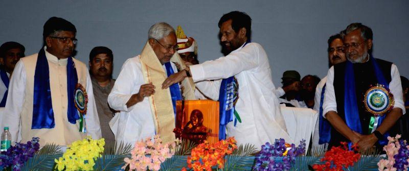 Bihar Chief Minister Nitish Kumar, Deputy Chief Minister Sushil Kumar Modi and Union Minister Ravi Shankar Prasad with Lok Janshakti Party (LJP) President Ram Vilas Paswan during a programme ... - Nitish Kumar and Sushil Kumar Modi