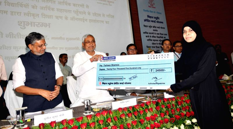 "Bihar Chief Minister Nitish Kumar during ""Student Credit Card Scheme"" distribution ceremony in Patna on Aug 11, 2018. Also seen  Bihar Deputy Chief Minster Sushil Kumar Modi. - Nitish Kumar"