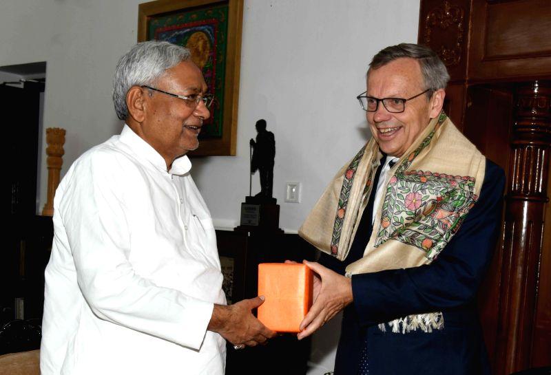 Bihar Chief Minister Nitish Kumar felicitates Norway Ambassador to India Nils Ragnar Kamsvag in Patna on Sept 13, 2017. - Nitish Kumar