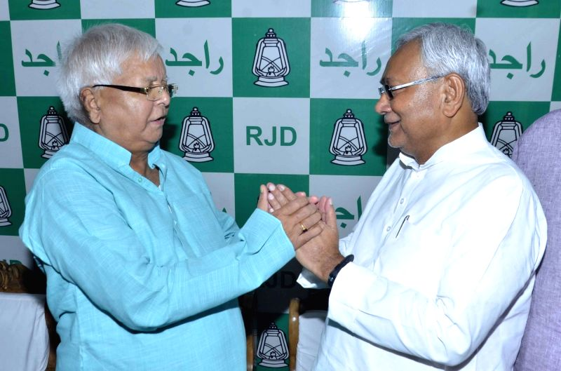 Bihar Chief Minister Nitish Kumar greets RJD supremo Lalu Prasad Yadav on his birthday in Patna on June 11, 2017. - Nitish Kumar and Lalu Prasad Yadav