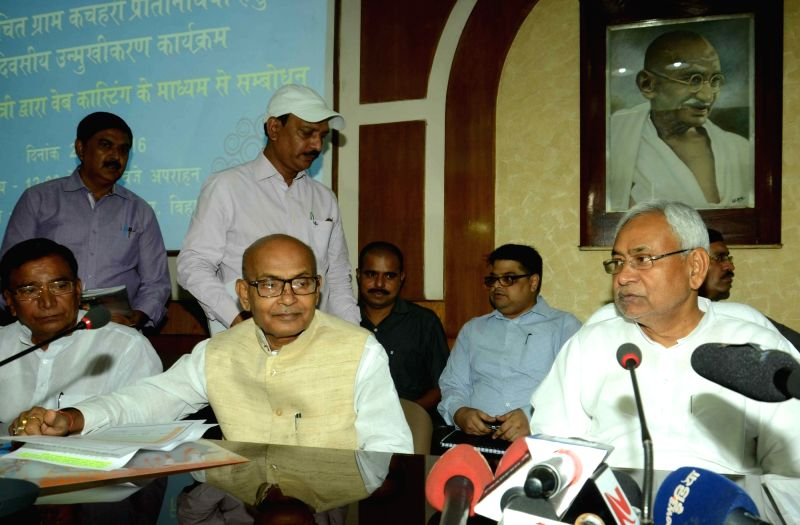 Bihar Chief Minister Nitish Kumar interacts with village Sarpanch during a video conference call in Patna on July 22, 2016. - Nitish Kumar
