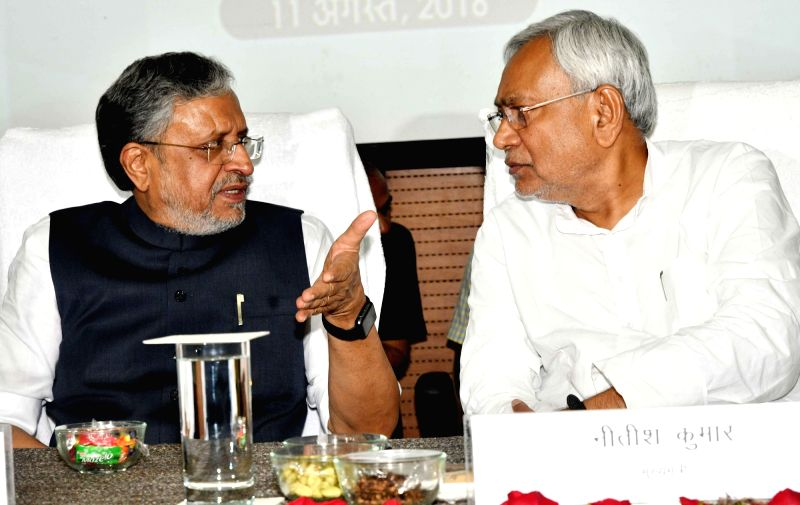 "Bihar Chief Minister Nitish Kumar interacts with Deputy Chief Minster Sushil Kumar Modi during ""Student Credit Card Scheme"" distribution ceremony in Patna on Aug 11, 2018. - Nitish Kumar"