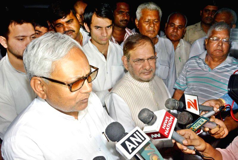 Bihar Chief Minister Nitish Kumar, JD(U) chief Sharad Yadav and RJD chief Lalu Prasad Yadav interact with media in Patna, on July 26, 2015. - Nitish Kumar, Sharad Yadav and Lalu Prasad Yadav