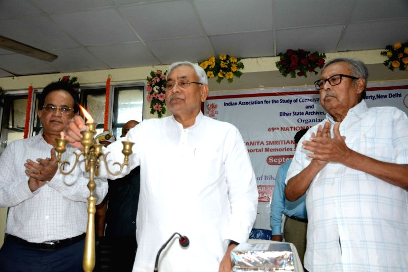 Bihar Chief Minister Nitish Kumar lights the lamp during 49th National Conference on Immortal Memories: Conservation and Management in Patna on Sept 13, 2017. - Nitish Kumar