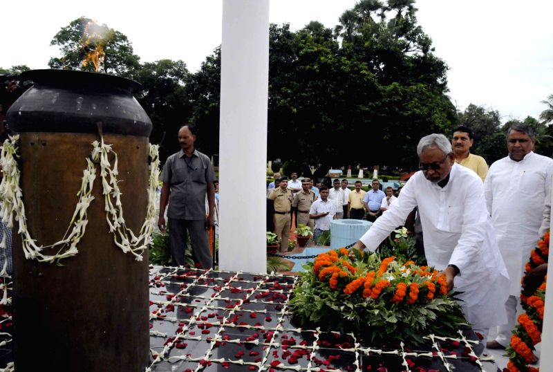 Bihar Chief Minister Nitish Kumar pays tribute to martyrs on Shahid Divas at state assembly in Patna on Aug 11, 2016. - Nitish Kumar
