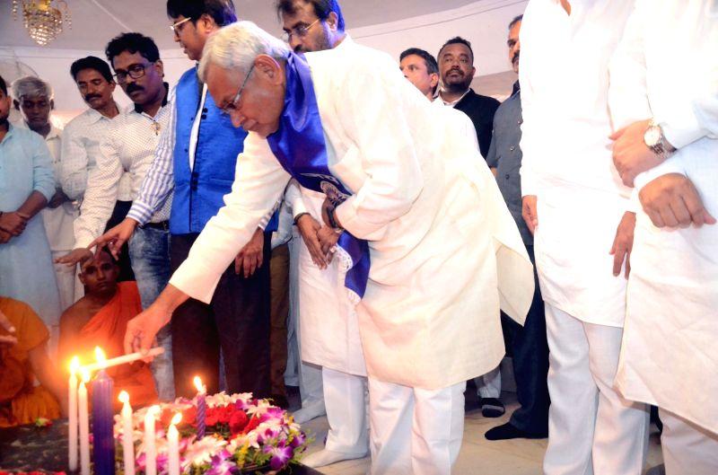 Bihar Chief Minister Nitish Kumar pays tribute to Dr Babasaheb Ambedkar at Chaityabhoomi in Mumbai on April 22, 2017. - Nitish Kumar