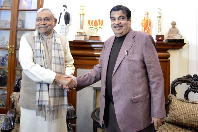 Bihar Chief Minister Nitish Kumar shakes hands with Union Transport Minister Nitin Gadkari during a meeting in New Delhi on Jan 31, 2018. - Nitish Kumar