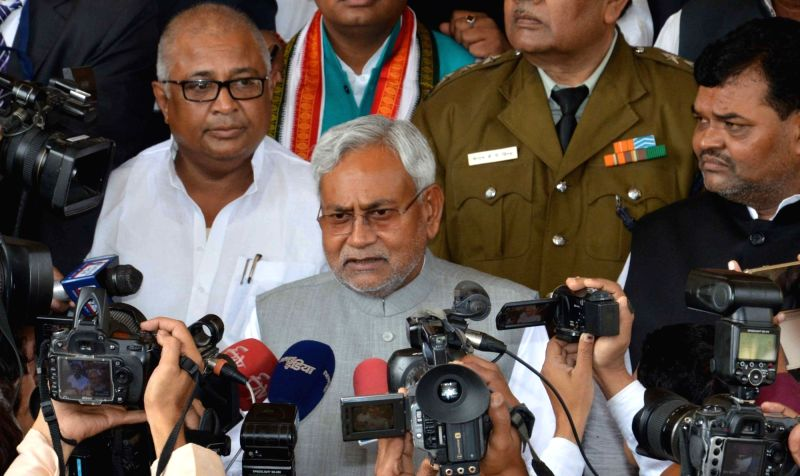 Bihar Chief Minister Nitish Kumar talks to press in Patna, on Dec 2, 2015.