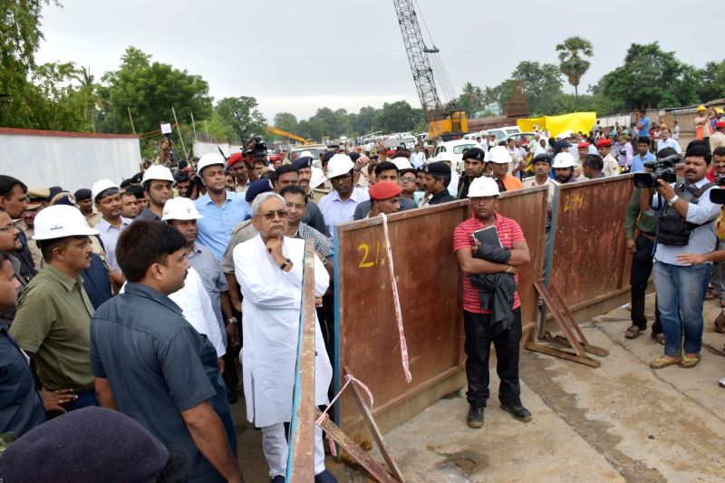Bihar Chief Minister Nitish Kumar visits the spot where a portion of Patna's Bailey road caved-in on July 29, 2018.The road, considered the life line of Bihar capital, caved in due to heavy ... - Nitish Kumar