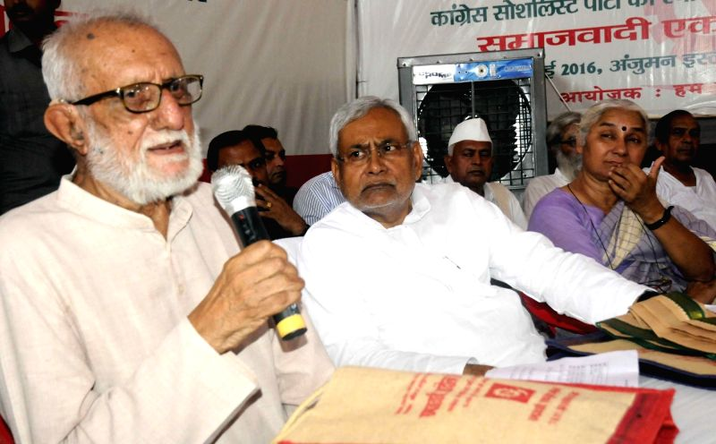Bihar Chief Minister Nitish Kumar with distinguished freedom fighter, philanthropist and civil rights activist GG Parikh and social activist Medha Patkar during a programme organised to ... - Nitish Kumar