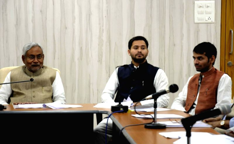 Bihar Chief Minister Nitish Kumar with Deputy Chief Minister and Heath Minister during a meeting in Patna on Nov 24, 2015.