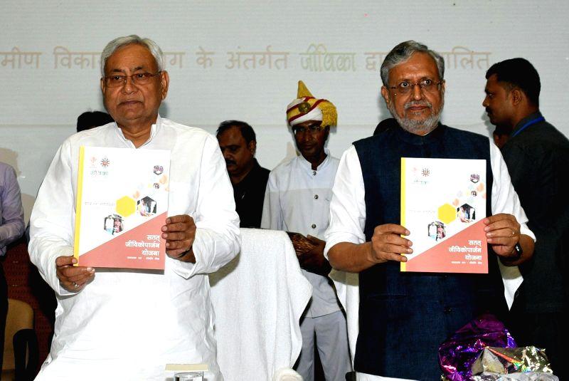 "Bihar Chief Minister Nitish Kumar with Deputy Chief Minster Sushil Kumar Modi art the launch of ""Satat Jivikoparjan Yojana"" in Patna, on Aug 5, 2018. - Nitish Kumar"