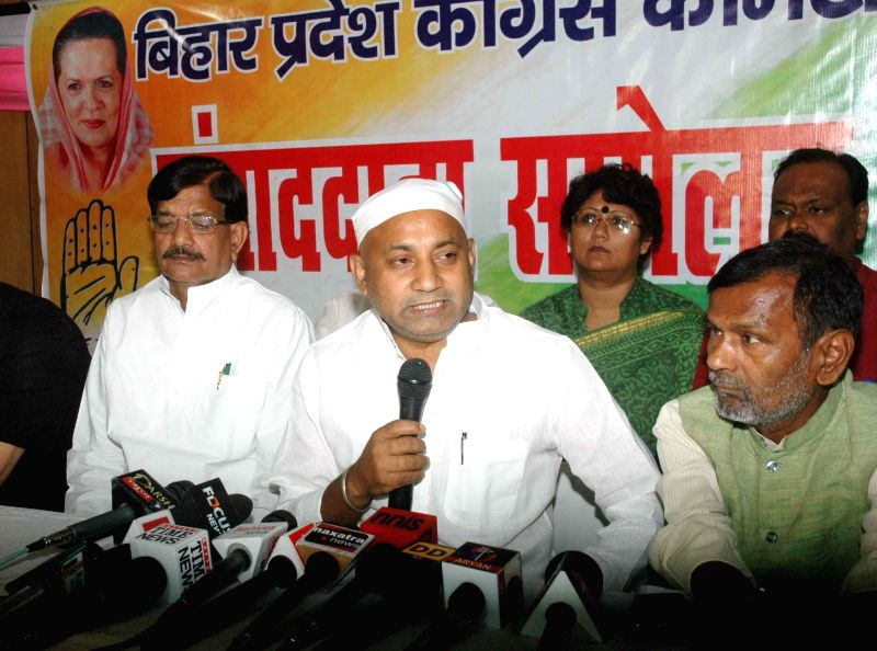 Bihar Congress chief Ashok Chaudhary addresses a press conference regarding party's performance in 2014 Lok Sabha Elections in the state, in Patna on May 16, 2014. - Ashok Chaudhary