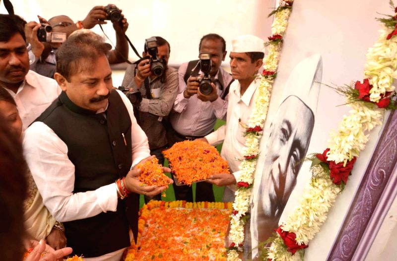 Bihar Congress chief Ashok Chaudhary pays tribute to former Prime Minister Pandit Jawaharlal Nehru on his 126th birth anniversary, in Patna on Nov 14, 2015. - Pandit Jawaharlal Nehru and Ashok Chaudhary