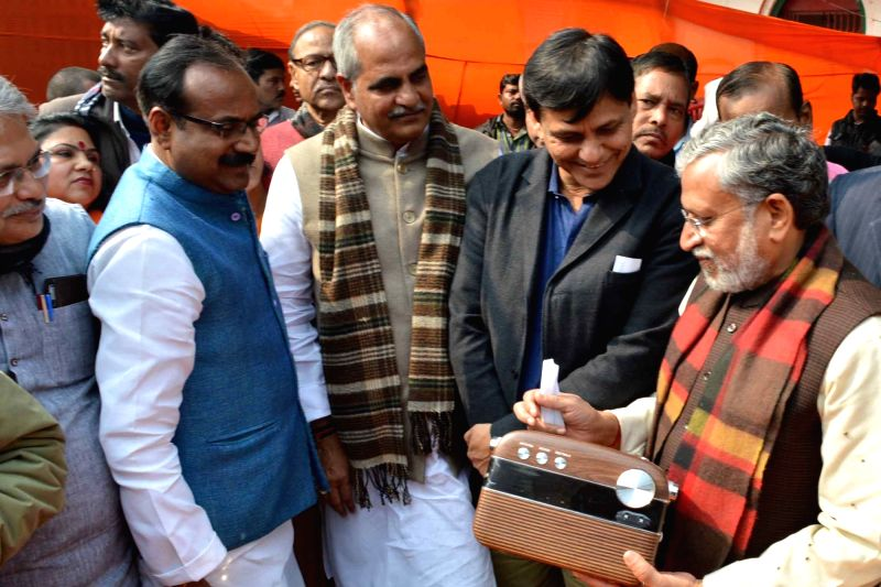 "Bihar Deputy Chief Minister and BJP leader Sushil Kumar Modi holds a transistor radio as he listens to  this year's first episode of Prime Minister Narendra Modi's radio talk ""Mann Ki ... - Narendra Modi, Sushil Kumar Modi and Nityanand Rai"