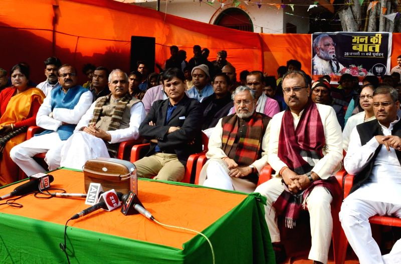 Bihar Deputy Chief Minister Sushil Kumar Modi, state's Health Minister Mangal Pandey and state BJP president Nityanand Rai during the broadcast of this year's first episode of Prime Minister ... - Sushil Kumar Modi, Mangal Pandey, Nityanand Rai and Narendra Modi