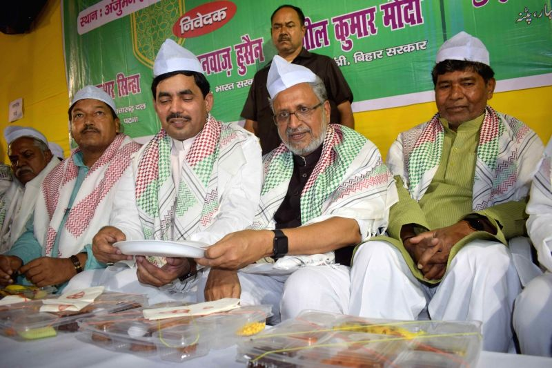 Bihar Deputy Chief Minister Sushil Kumar Modi and BJP leader Shahnawaz Hussain at an Iftar party organised during the Muslim holy month of fasting - Ramadan, in Patna on June 8, 2018. - Sushil Kumar Modi