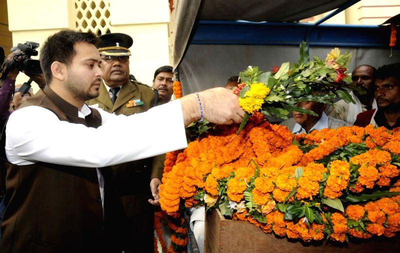 Bihar Deputy Chief Minister Tejashwi Yadav pays his last respect to late CPI leader Ramashray Prasad Singh in Patna, on Dec 7, 2015.