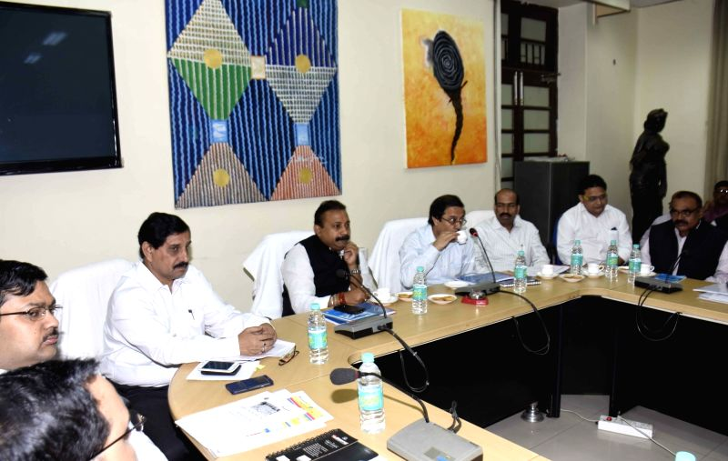 Bihar Education Minister Ashok Chaudhary during a meeting with officials in Patna, on Nov 24, 2015. - Ashok Chaudhary