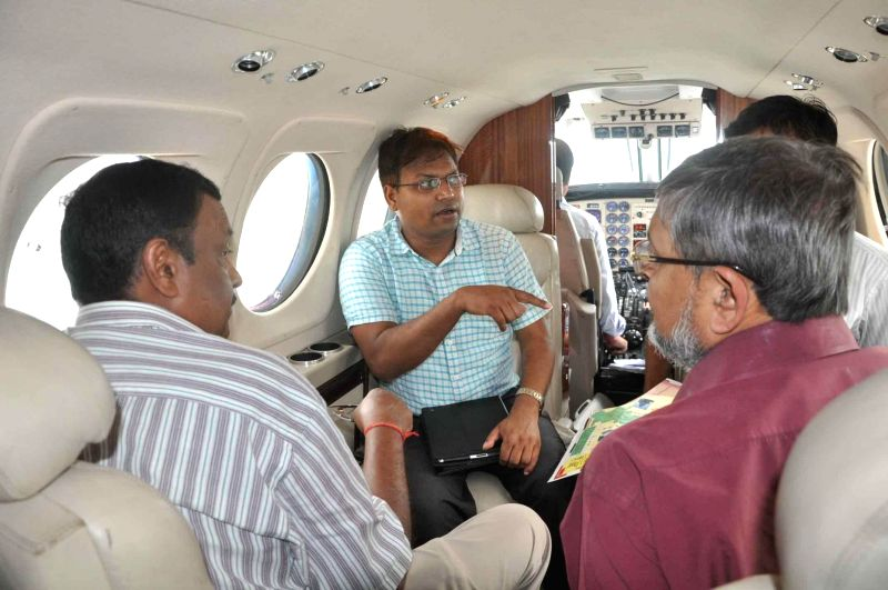 Bihar government officials during an aerial survey of flood affected Nawada and Nalanda districts of the state.