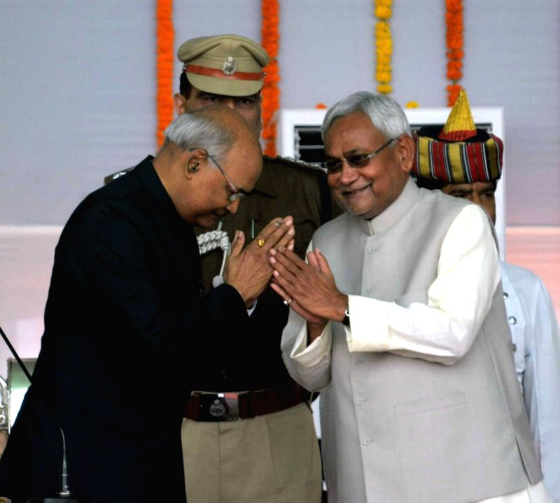 Bihar Governor Ram Nath Kovind greets Nitish Kumar after he took oath as the Chief Minister of Bihar in Patna, on Nov 20, 2015. - Nath Kovind