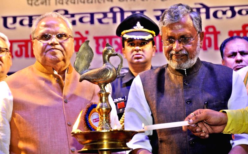 Bihar Governor Satyapal Malik and Deputy Chief Minister Sushil Kumar Modi during a programme, in Patna on June 14, 2018. - Sushil Kumar Modi and Malik
