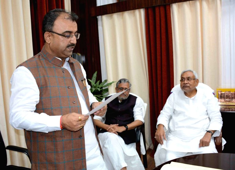 Bihar Health Minister Mangal Pandey takes oath as MLC in the chamber of Chairman of Bihar State Legislative Council Harun Rashid in Patna, on May 21, 2018. - Mangal Pandey