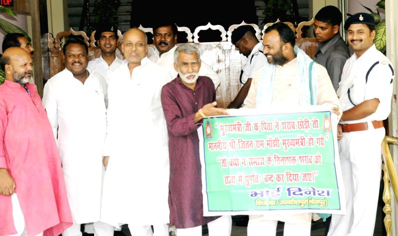 Bihar RJD legislators demonstrate to press for ban on liquor in the state in Patna on July 1, 2014.