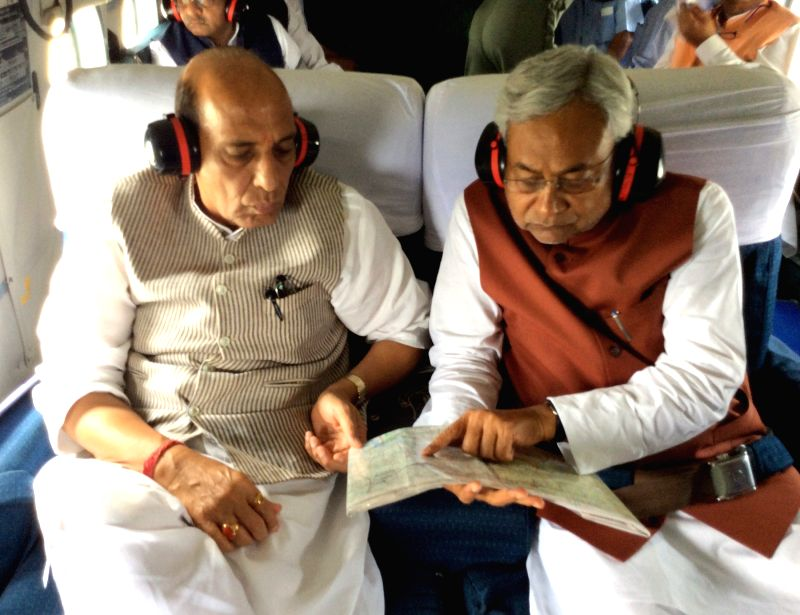 Union Home Minister Rajnath Singh and Bihar Chief Minister Nitish Kumar undertake an aerial survey of the storm affected Madhepura and Purnia of Bihar on April 24, 2015. - Rajnath Singh and Nitish Kumar