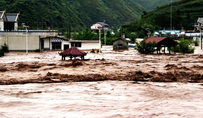 Photo taken on Aug. 12, 2014 shows the flooded Chuandong Village of Weining County, southwest China's Guizhou Province. The death toll from continuous rains in ...