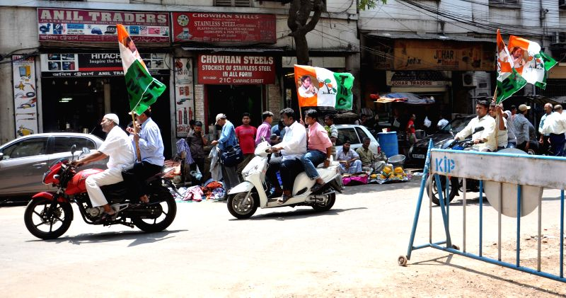 Bike- borne Trinamool Congress workers during an election campaign in Kolkata on April 23, 2014.
