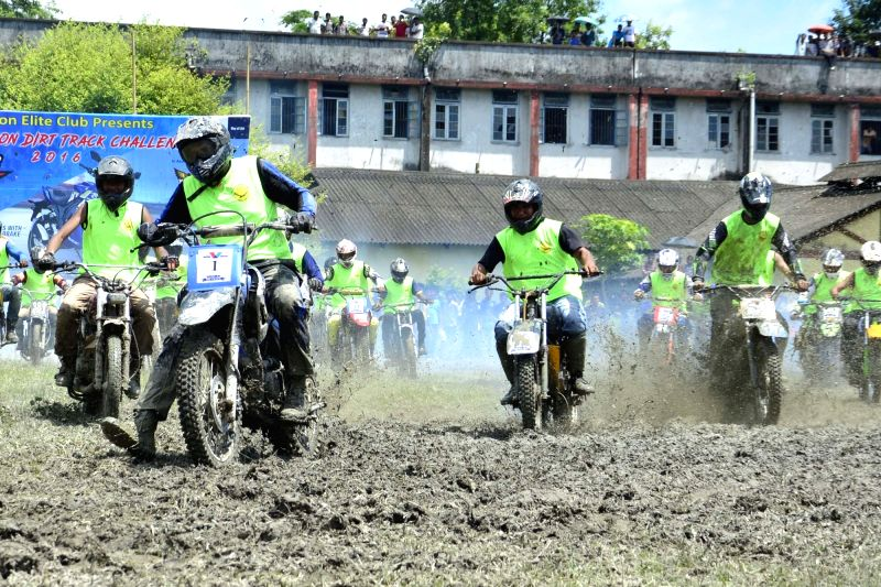 Bikers participate in Monsoon Dirt Track Challenge 2016 in Nagaon of Assam on July 31, 2016.