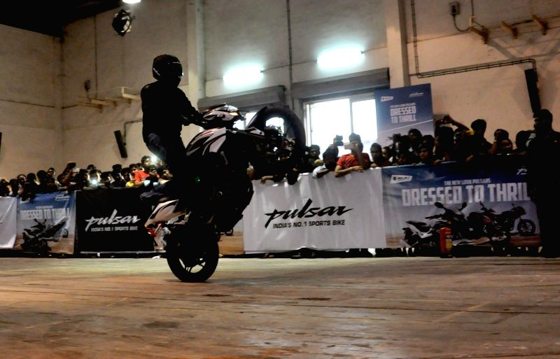 Bikers perform stunts during Pulsar carnival in Kolkata on July 27, 2014.