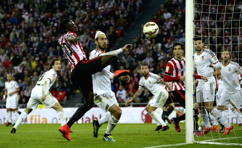 Athletic Bilbao's striker Inaki Williams (L) tries to score against FC Valencia during their Primera Division soccer match played at San Mames stadium in Bilbao, Basque Country, Spain on 09 ...