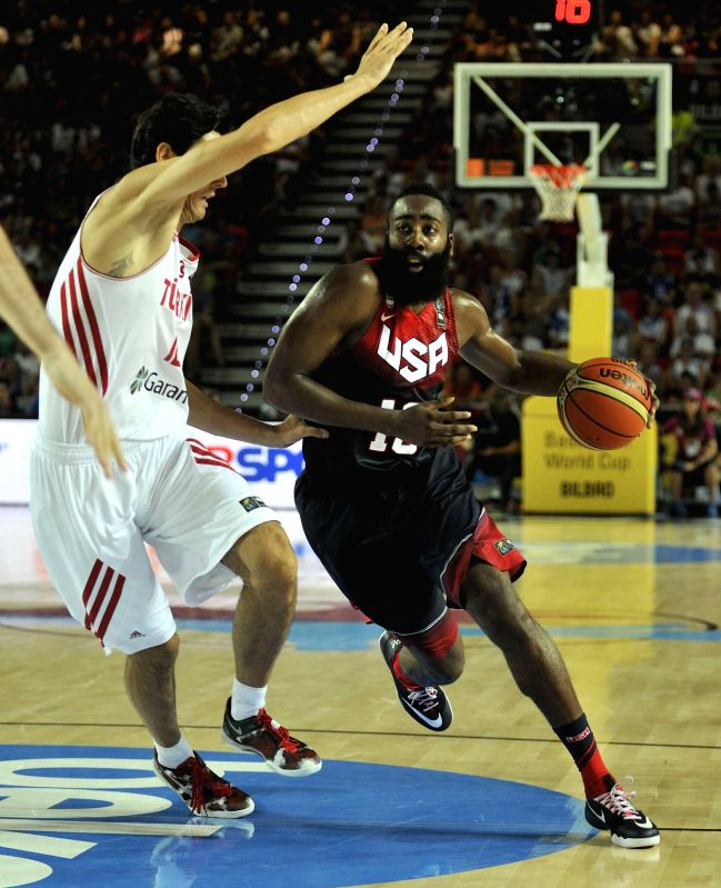 James Harden (R) of the United States drives the ball during the Group C match between the United States and Turkey at the 2014 FIBA Basketball World Cup, in Bilbao,