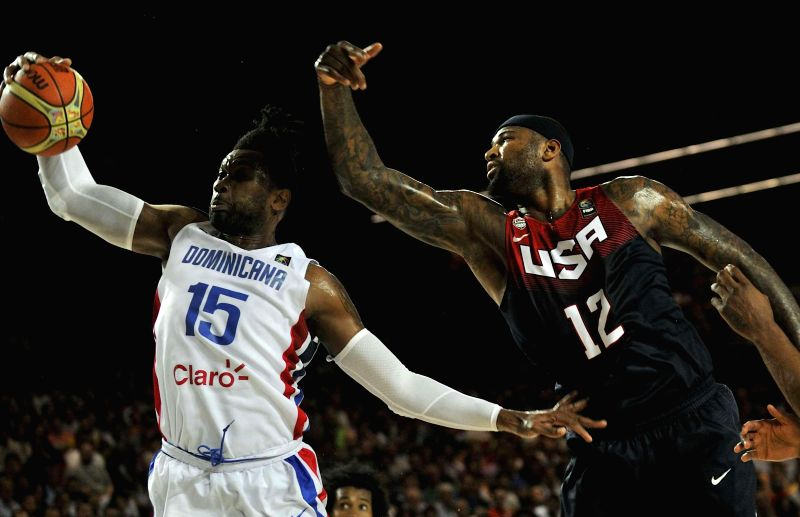 DeMarcus Cousins (R) of the United States vies for the ball with Jack Martinez of Dominican Republic during their group C match at the 2014 FIBA Basketball World ...