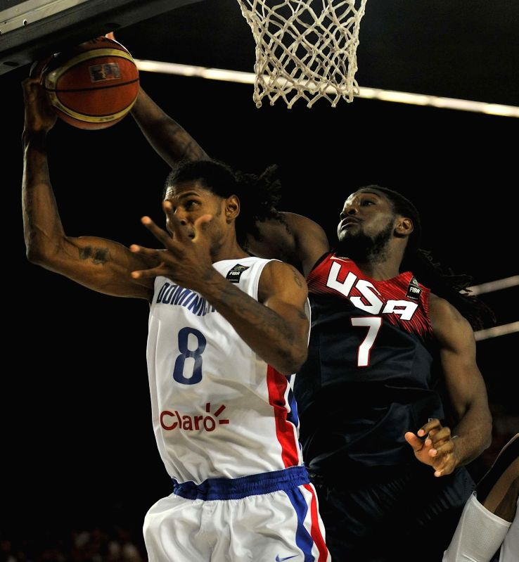 Kenneth Faried (R) of the United States vies with Edward Santana of Dominican Republic during their group C match at the 2014 FIBA Basketball World Cup, in Bilbao, ..